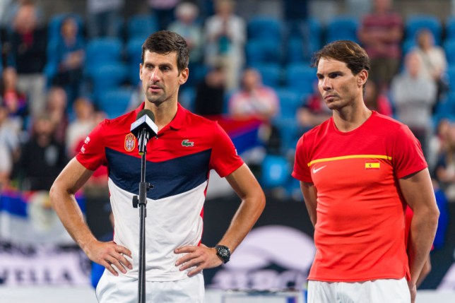 Novak Djokovic of Serbia talks while  Rafael Nadal of Spain looks on during the trophy presentation ceremony  during day 10 of the ATP Cup at Ken Rosewall Arena on January 12, 2020 in Sydney, Australia.