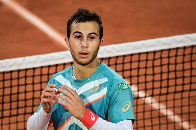 France's Hugo Gaston reacst as he wins against Switzerland's Stanislas Wawrinka during their men's singles third round tennis match on Day 6 of The Roland Garros 2020 French Open tennis tournament in Paris on October 2, 2020.