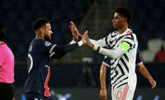 Neymar and Marcus Rashford high five after Manchester United's win over PSG