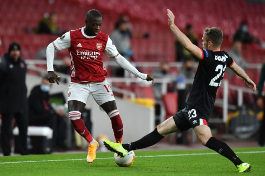 Nicolas Pepe runs with the ball in Arsenal clash with Dundalk