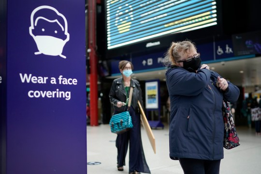 A woman wearing a face mask in Liverpool station.