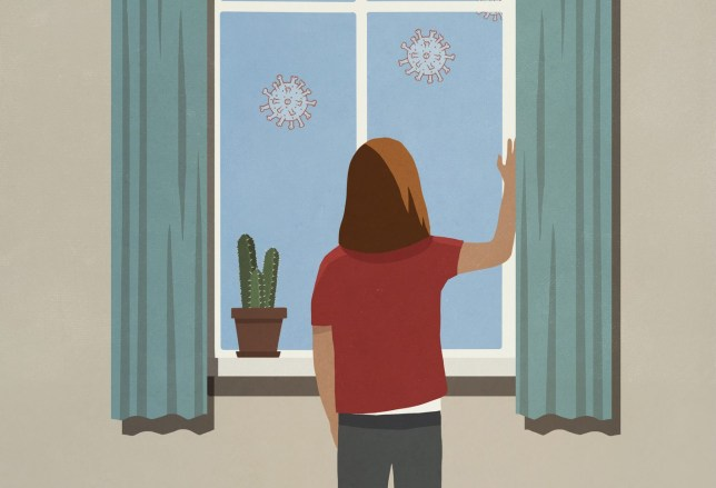 Woman at window watching floating coronavirus particles