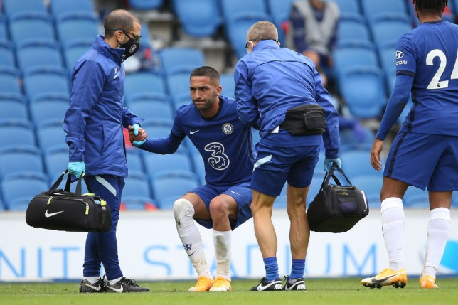 Hakim Ziyech winces after suffering a knee injury in Chelsea's clash with Brighton