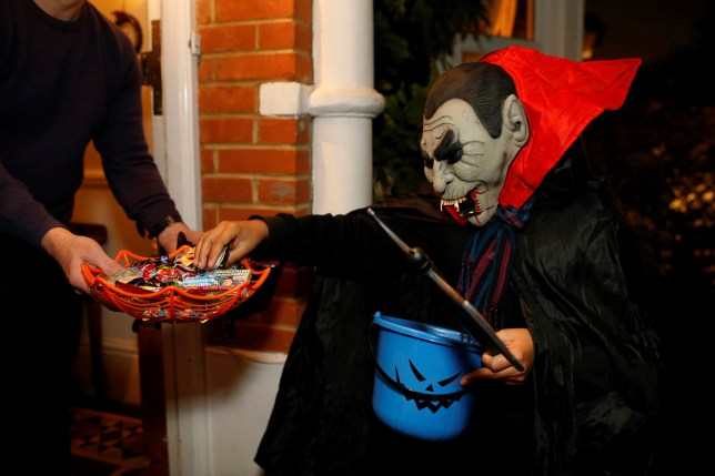 Child playing trick or treat