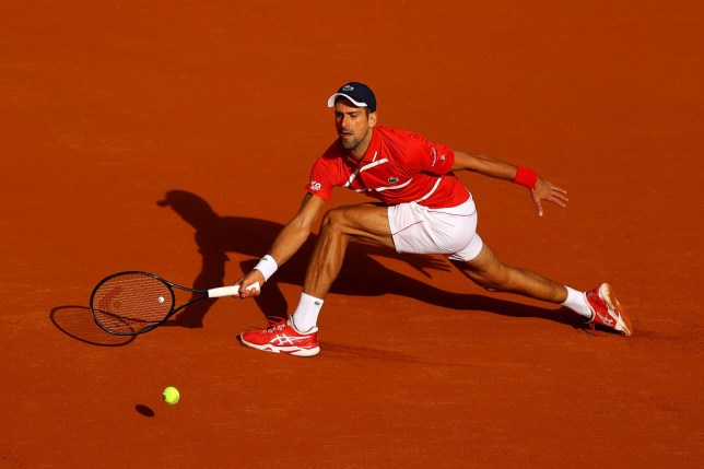 Novak Djokovic of Serbia plays a forehand during his Men's Singles second round match against Ricardas Berankis of Lithuania on day five of the 2020 French Open at Roland Garros on October 01, 2020 in Paris, France
