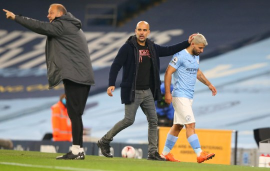Pep Guardiola pats Sergio Aguero on the head after his substitution in Manchester City's win over Arsenal