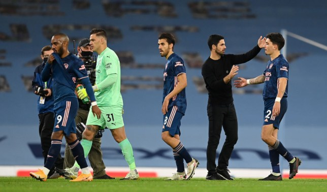 Mikel Arteta and Arsenal stars Alexandre Lacazette, Dani Ceballos and Hector Bellerin look on after their Premier League defeat to Manchester City