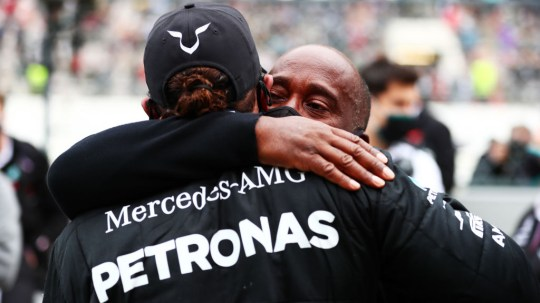 Lewis Hamilton celebrates his 92nd race win with his father Anthony