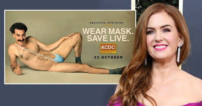 Isla Fisher pictured alongside poster of Borat wearing nothing but face mask