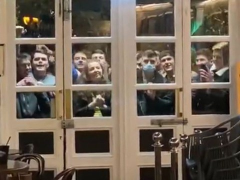 Football fans get around 10pm pub curfew by watching penalties on TV through window
