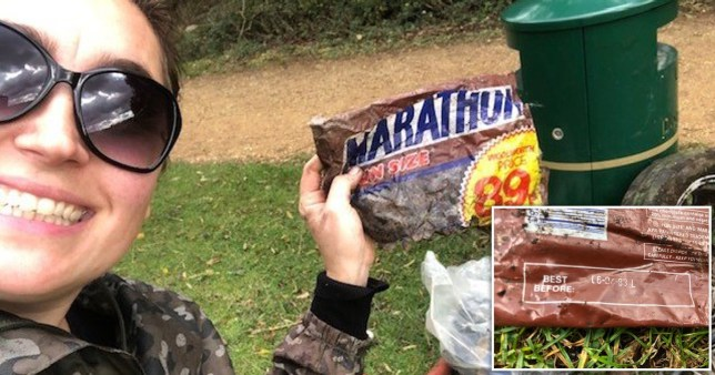 A woman wearing sunglasses holds an old Marathon wrapper