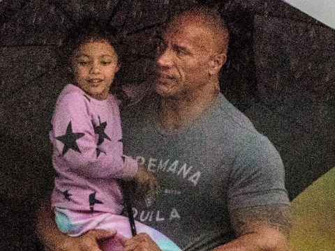 Dwayne 'The Rock' Johnson shelters daughter from the rain as family touch down in Atlanta