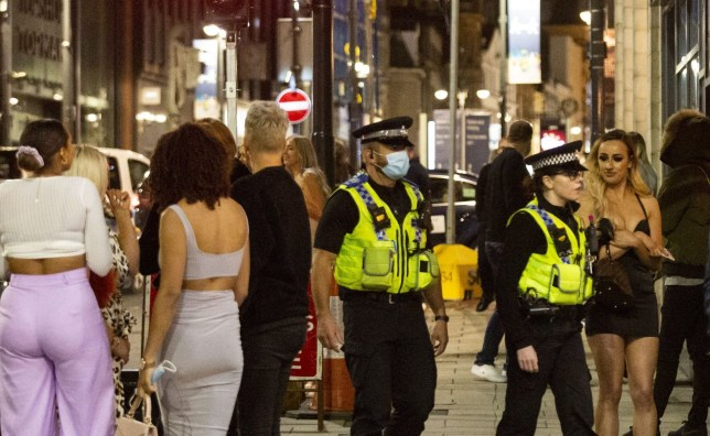 *DAILY MAIL* Police officers patrol bars as they enforce the curfew. Clubs and bars, in Leeds city centre, close at 10pm due to the new government announcement, pictured in Leeds, West Yorks, Sep 26 2020.