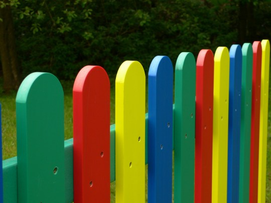 multicoloured fence pales