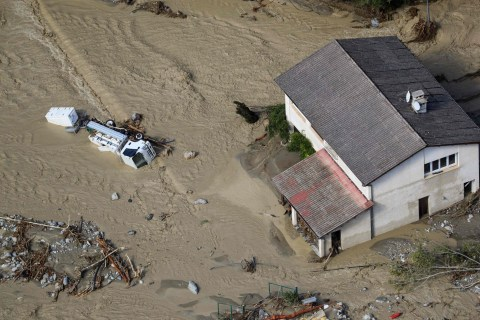 TOPSHOT - This aerial view taken on October 3, 2020 shows the damage in Saint-Martin-Vesubie, southeastern France, after heavy rains and floodings hit the Alpes-Maritimes department. - Heavy rains and brutal floods have left villages cut off from the world in the Alpes Maritimes, where hundreds of fire-fighters have been mobilised on October 3, to find nine missing persons. (Photo by Valery HACHE / AFP) (Photo by VALERY HACHE/AFP via Getty Images)