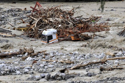 TOPSHOT - This general view shows a partially submerged truck in the River Vesubie at Roquebilliere, south-eastern France, on October 3, 2020, after the waters of the swollen river surged through the town in the Alpes-Maritimes department. - One person died and authorities listed some 20 as missing after heavy storms lashed southern France and northern Italy with hundreds of aid workers deployed to villages cut off by the deluge. (Photo by NICOLAS TUCAT / AFP) (Photo by NICOLAS TUCAT/AFP via Getty Images)
