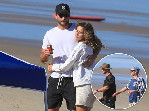 Liam Hemsworth cuddles up to girlfriend Gabriella Brooks for fun beach day with brother Chris and Taika Waititi