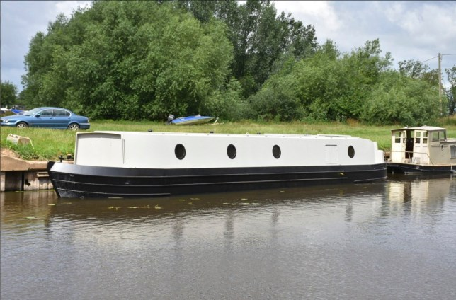 Man who couldn't afford a mortgage builds himself a houseboat instead