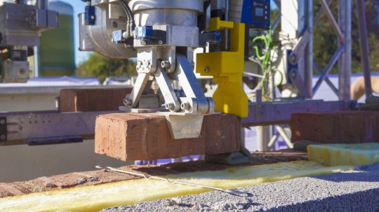 A three bedroom house is being built brick by brick from the ground up by a robot (Credits: tprc / SWNS)