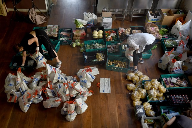 LONDON, ENGLAND - APRIL 10: Volunteers from the Islington Covid-19 Mutual Aid group preparing food parcels for a weekly distribution to members of their community who are in self-isolation and experiencing financial difficulties on April 10, 2020 in London, England. There have been over 60,000 reported cases of the COVID-19 coronavirus in the United Kingdom and 7,000 deaths. The country is in its third week of lockdown measures aimed at slowing the spread of the virus. (Photo by Kate Green/Getty Images)