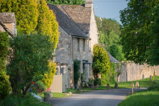 A Cotswolds stone house on a village road