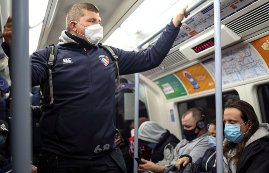 Commuters travel on a Jubilee line tube train during the morning rush hour, amid the outbreak of the coronavirus disease (COVID-19) in London Britain, October 15, 2020. REUTERS/Hannah McKay