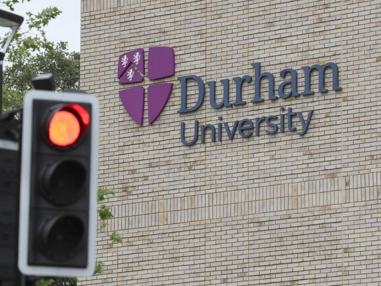 The Durham University sign on the side of the building.