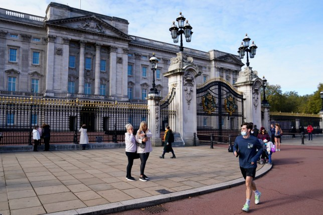 Members of the public and tourists outside Buckingham Palace.
