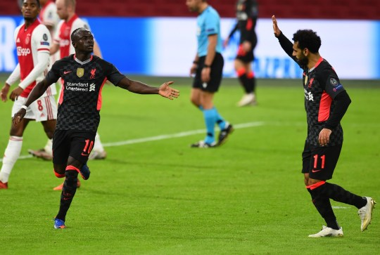 Sadio Mane of Liverpool shoots for goal but goes in of Nicolas Tagliafico and celebrates of Ajax during the UEFA Champions League Group D stage match between Ajax Amsterdam and Liverpool FC