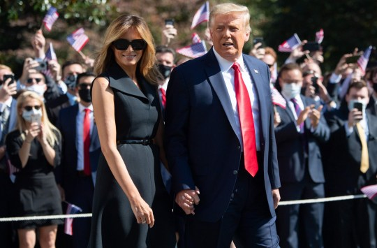US President Donald Trump and First Lady Melania Trump walk to Marine One prior to departing from the South Lawn of the White House in Washington, DC, on October 22, 2020. - President Trump travels to Nashville, Tennessee, for the final presidential debate. (Photo by SAUL LOEB / AFP) (Photo by SAUL LOEB/AFP via Getty Images)