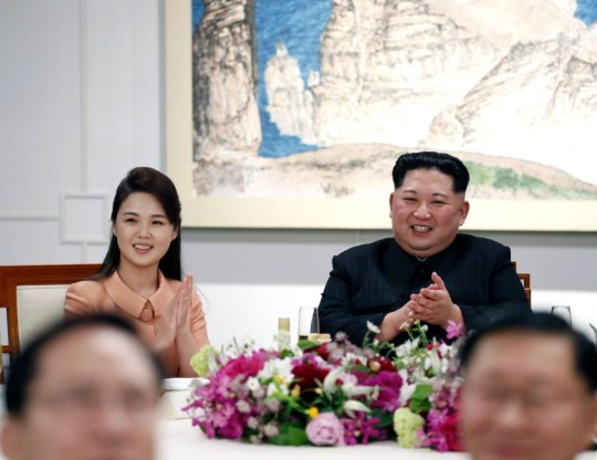 North Korea's leader Kim Jong Un (R) and his wife Ri Sol-ju during Inter-Korean Summit 2018 in Panmunjom on April 27, 2018. - The leaders of the two Koreas held a landmark summit on April 27 after a highly symbolic handshake over the Military Demarcation Line that divides their countries, with the North's Kim Jong Un declaring they were at the 'threshold of a new history'. (Photo by Inter Korean Press Corp/NurPhoto via Getty Images)