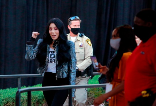 U.S. singer actress Cher raises her fist while preparing to take the stage before at the Joe Biden campaign rally in Las Vegas