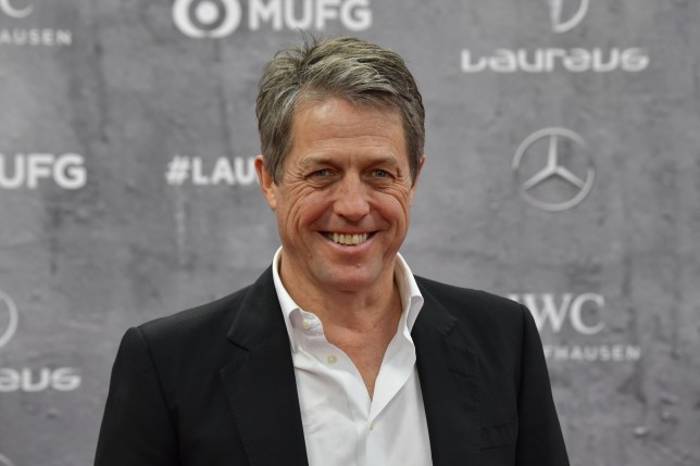 English actor Hugh Grant poses on the red carpet prior to the 2020 Laureus World Sports Awards ceremony in Berlin on February 17, 2020. (Photo by Tobias SCHWARZ / AFP) (Photo by TOBIAS SCHWARZ/AFP via Getty Images)