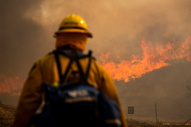 Firefighters work at controlling the Silverado Fire burning near Irvine in Orange County, South of Los Angeles, California, USA, 26 October 2020.