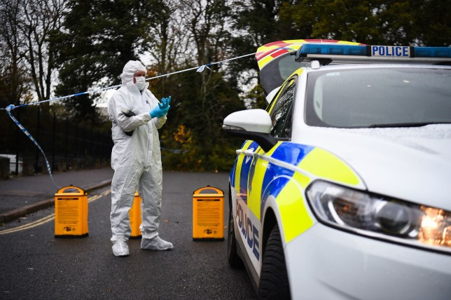 A forensic officer at the scene on Russell Way in Crawley, West Sussex, after a 24-year-old man was fatally stabbed on Tuesday night. PA Photo. Picture date: Wednesday October 28, 2020. Photo credit should read: Kirsty O'Connor/PA Wire