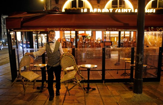 A barman closes his establishment at 9pm as part of a city-wide night time curfew
