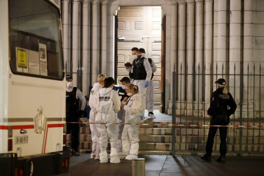 epa08783884 French police investigators stand in front of the entrance of the Notre Dame Basilica church in Nice, France, 29 October 2020, following a knife attack. Three people have died in what officials treat as a terror attack. The attack comes less than a month after the beheading of a French middle school teacher in Paris on 16 October. EPA/SEBASTIEN NOGIER