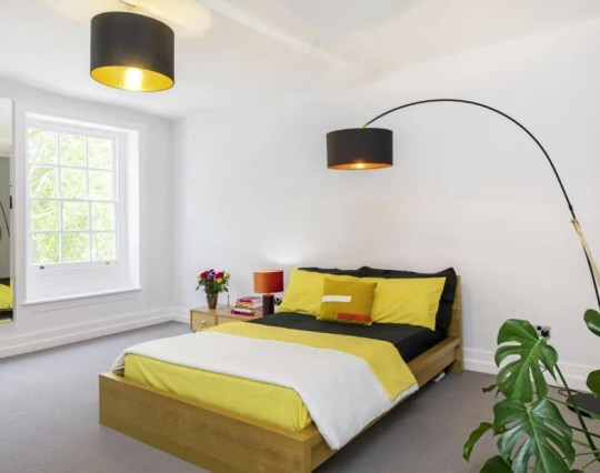 'Extremely rare' house on the oldest terrace in London up for sale - bedroom with yellow bedding