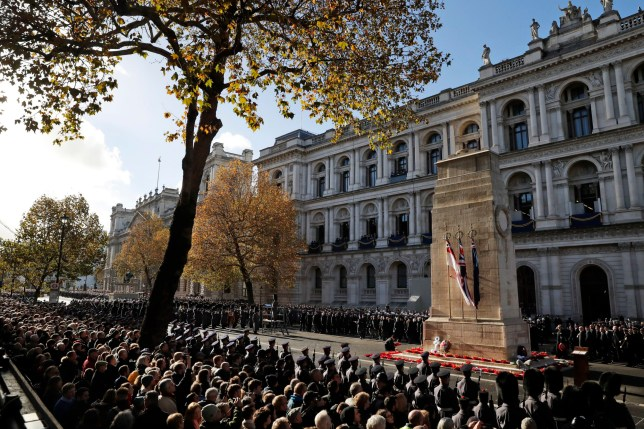 People attend the Remembrance Sunday ceremony at the Cenotaph in London, Sunday, Nov. 11, 2018. Remembrance Sunday is held each year to commemorate the service men and women who fought in past military conflicts. 2018 marks the centenary of the armistice and cessation of hostilities in WWI, which ended on the eleventh hour of the eleventh day of the eleventh month,1918. (AP Photo/Alastair Grant)