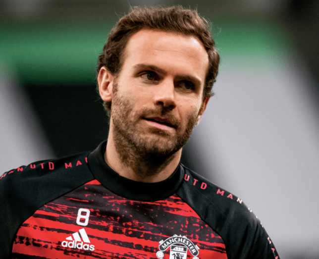 Former Chelsea star Juan Mata looks on in Manchester United warm-up