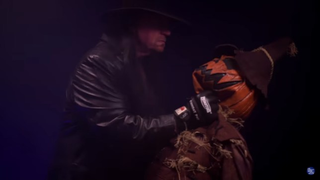 WWE legend The Undertaker attacks a scarecrow on the Tonight Show Starring Jimmy Fallon