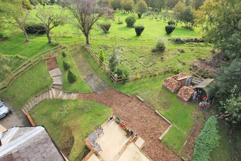 gatehouse with its own turret for sale - aerial view of the gardens