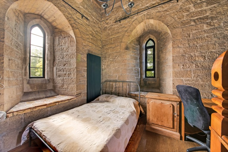 bedroom and desk in victorian church turned into family home