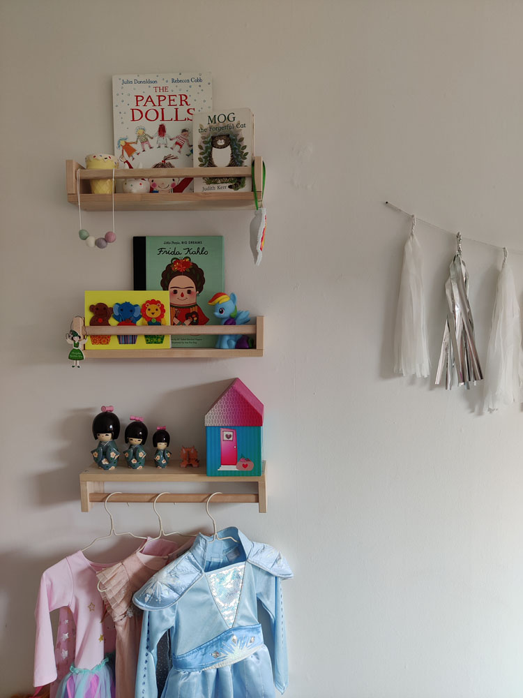 What I Rent: Megan, Falkirk - shelves in child's bedroom including children's books, Disney dressup costumes, and dolls
