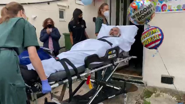 Anil Patel arrives home to balloons put up by his family after spending seven months in hospital fighting Covid-19 (Picture: Anil Patel / Metro)