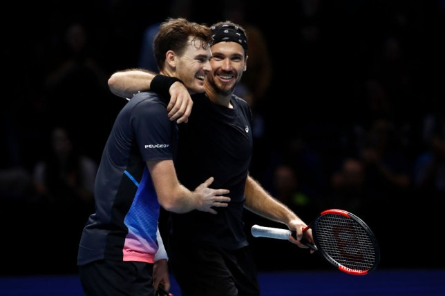 Jamie Murray of Great Britain and Bruno Soares of South Africa celebrate during their match against Michael Venus of New Zealand and Raven Klaasen of South Africa  during Day One of the Nitto ATP Finals at The O2 Arena on November 11, 2018 in London, England.