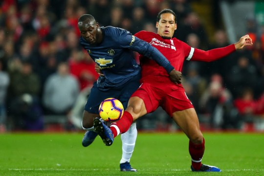Romelu Lukaku of Manchester United and Virgil van Dijk of Liverpool  during the Premier League match between Liverpool FC and Manchester United at Anfield on December 16, 2018 in Liverpool, United Kingdom.