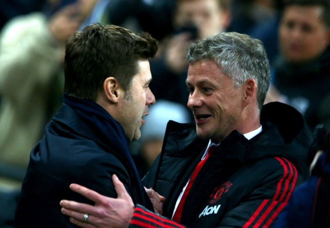 Tottenham Manager Mauricio Pochettino and Manchester United caretaker Manager Ole Gunnar Solskjaer meet each other at the beginning of the Premier League match between Manchester United and Tottenham Hotspur at Wembley Stadium on January 13, 2019 in London, United Kingdom.