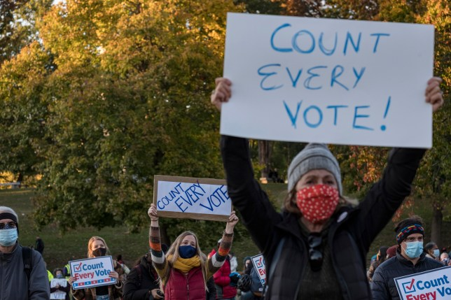 Kaley McCarty of Brighton, Massachusetts, center,  joined protesters who gathered on Boston Common on Nov. 4, 2020 to demand that every vote be counted a day after presidential elections were held in the US.