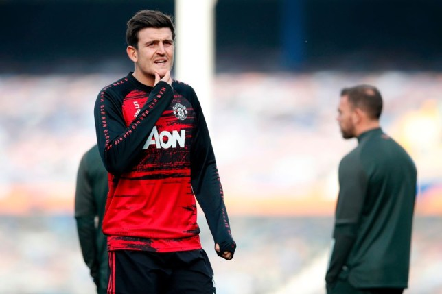 Harry Maguire looks on ahead of Manchester United's Premier League clash with Everton